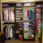 Reach-in Closet in Brown Pearwood with Chrome Baskets