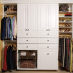 White Wall Closet with Decorative Foil Doors and Crown Mould