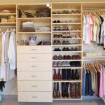 Wall Closet in Maple Woodgrain with Glass Doors and Tilted Shoe Shelves with Rails